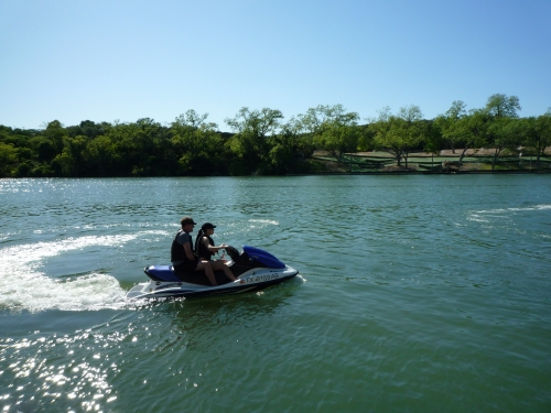 John and Amanda zipping around on a jet ski